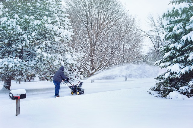 Snow removal service in residential areas in early morning with safety salt application