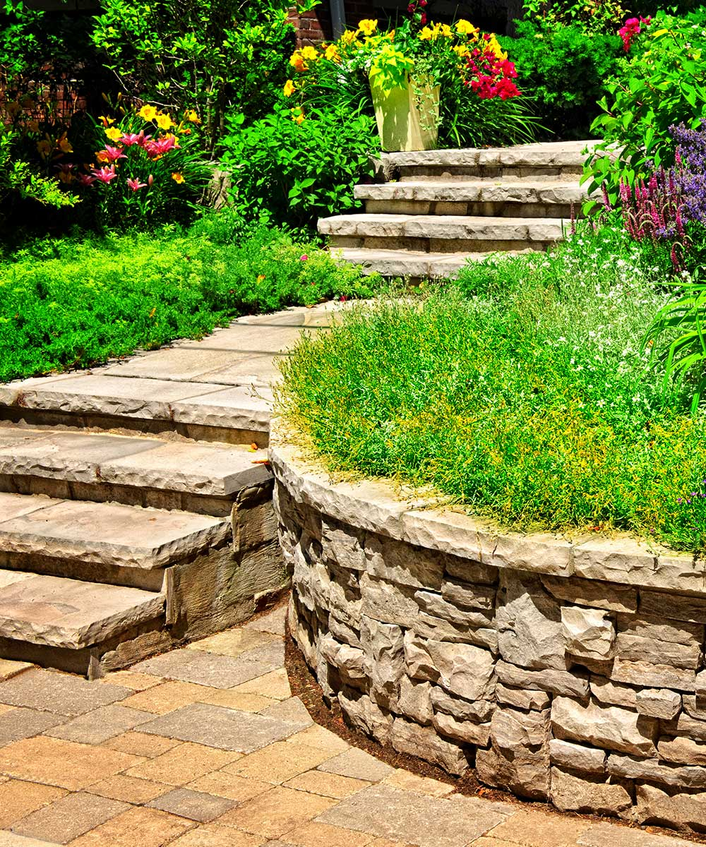 Retaining wall installation service in Edmonton and surrounding areas. We are here to support your soil laterally so that it can be retained at different level on the two sides.