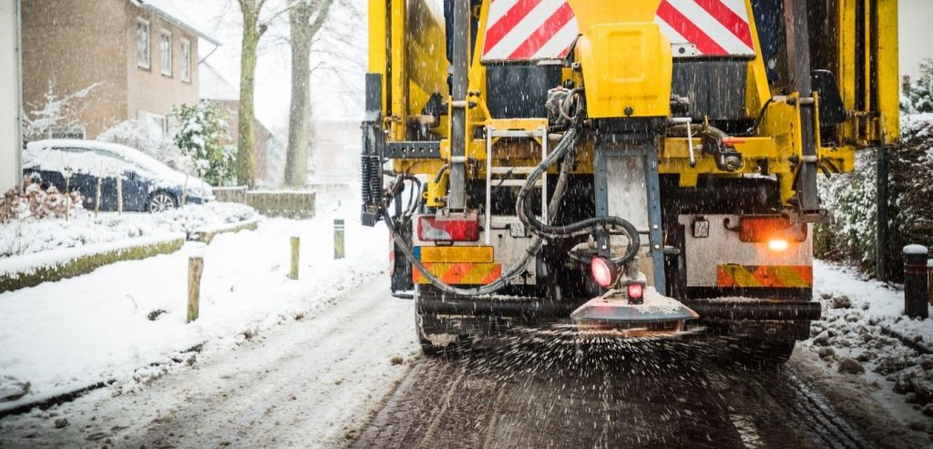 Snow removal service with de-icing